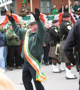 2010 Grand Marshal Hugh Dugan gets the crowd going during the 2011 St. Patrick's Day Parade.