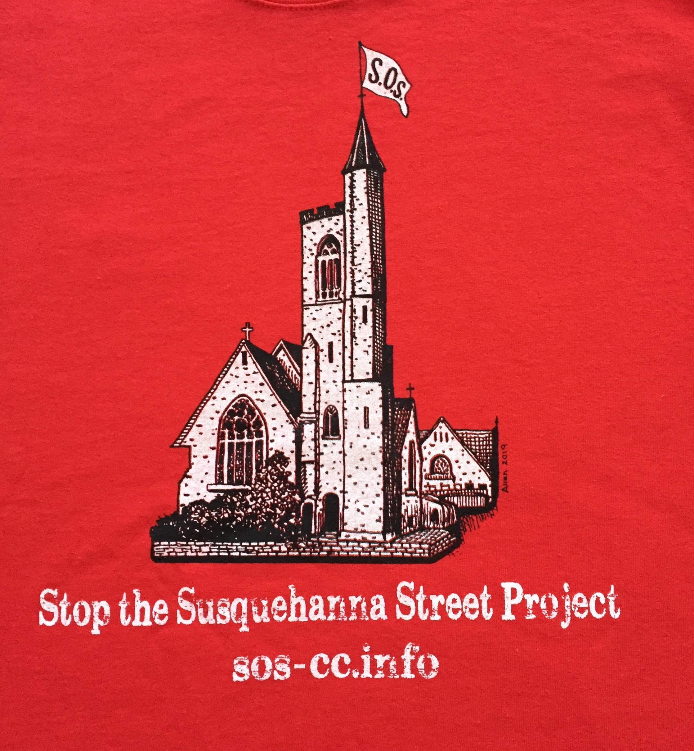 Stop the Susquehanna Street Project Tshirt image of St. Mark's Church with an SOS flag at the tower.