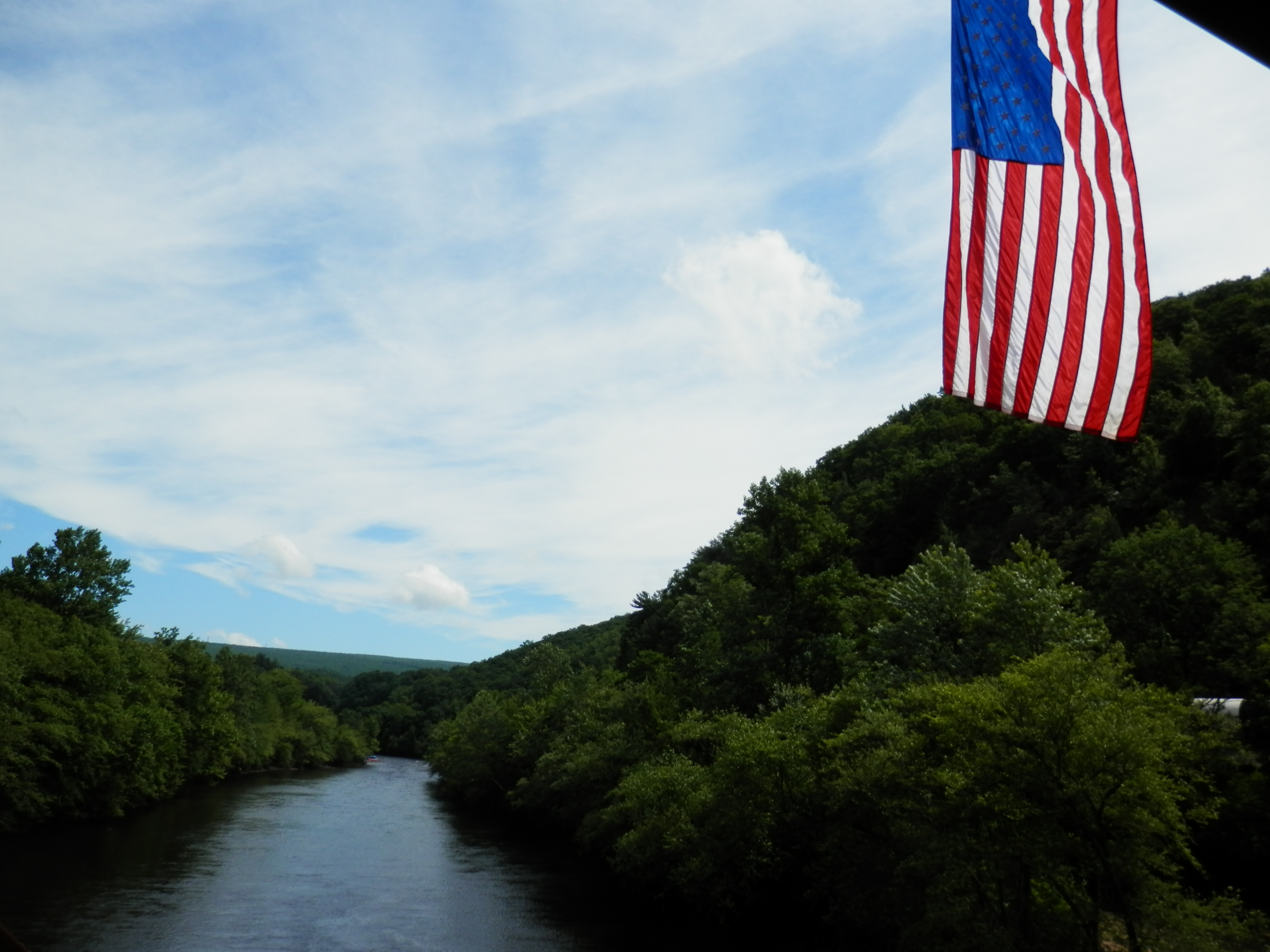 View of the Lehigh River from the American flag bedecked Mansion House pedestrian bridge.
